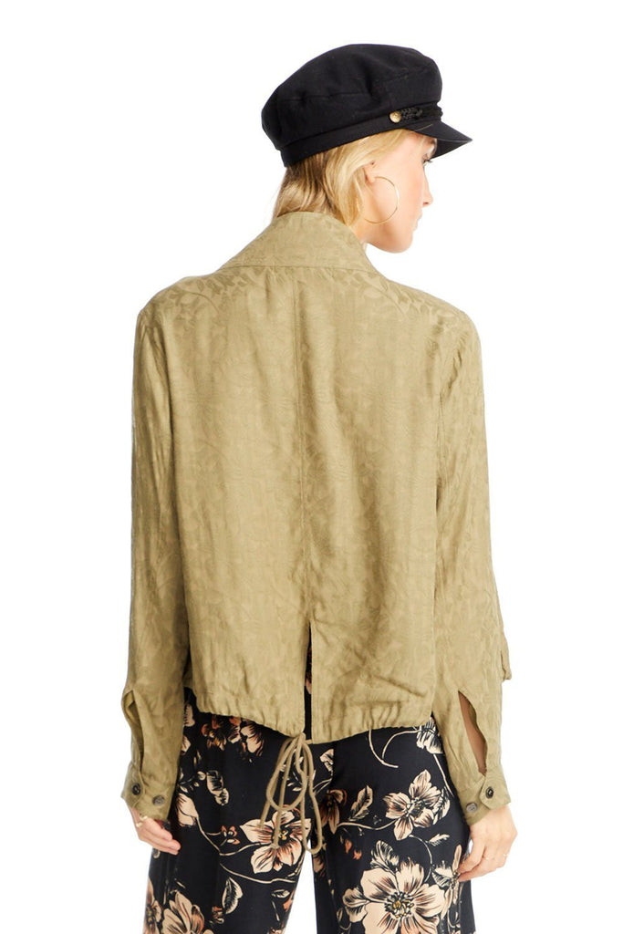 the back of a Saltwater Luxe olive textured jacket with tie detail