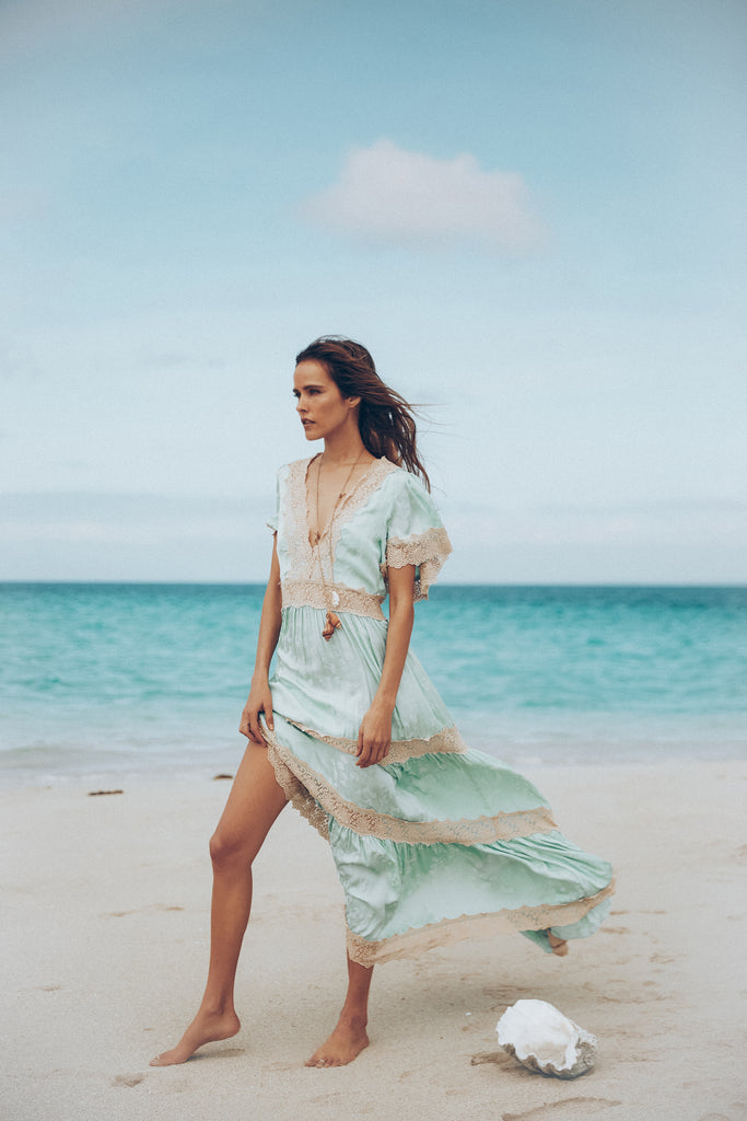 model in Spell & The Gypsy Collective Seafoam Ocean Gown on beach