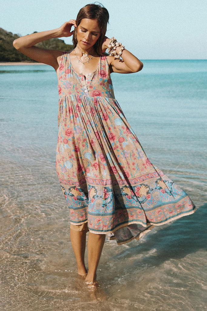 Spell & The Gypsy Collective Opal Seashell Babydoll Midi Dress on the beach