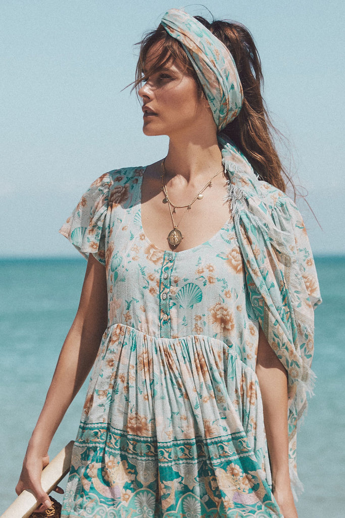 model wearing Spell & The Gypsy Collective Seafoam Seashell Travel Scarf as headscarf