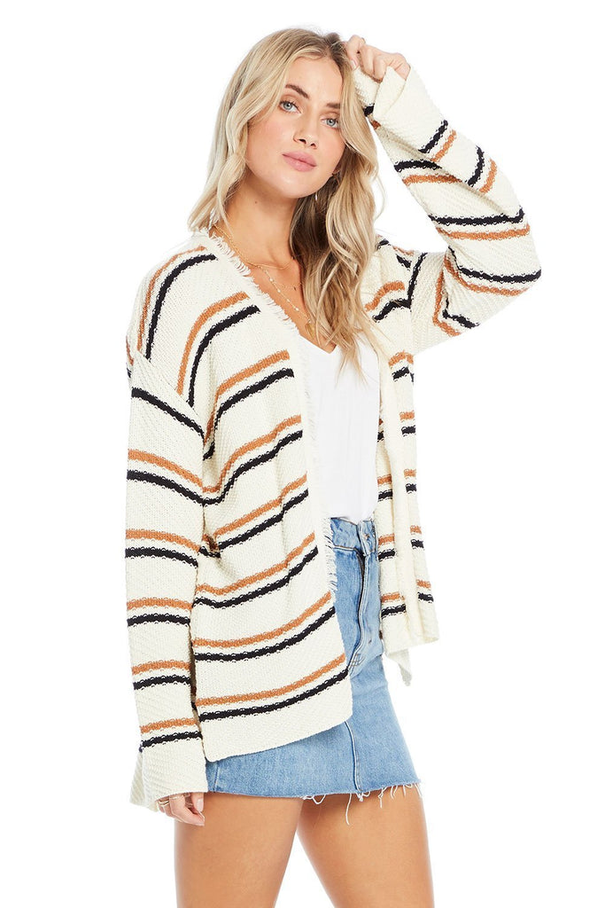 side of open striped cardigan over white tee shirt and denim shorts