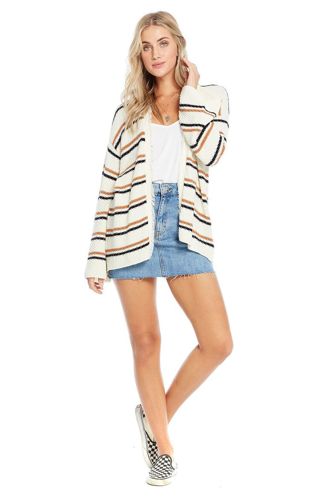 full body look of striped cream cardigan with white tee shirt and denim skirt