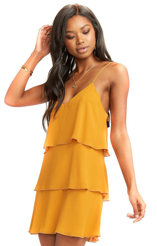 strappy mustard dress with three tiers of ruffles