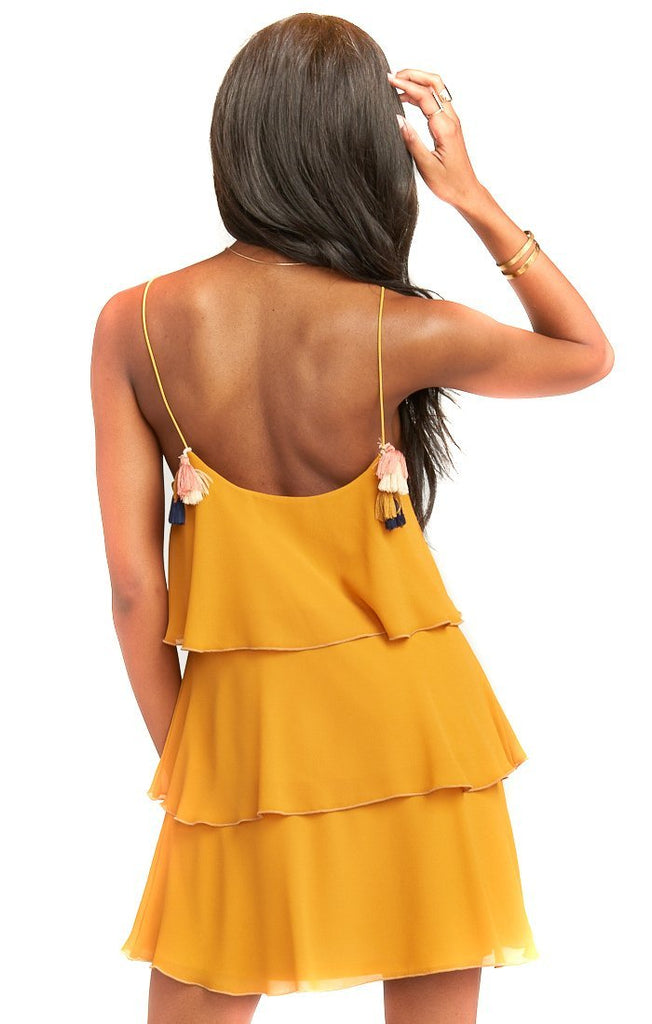 mustard dress with multi colored tassels and scoop back