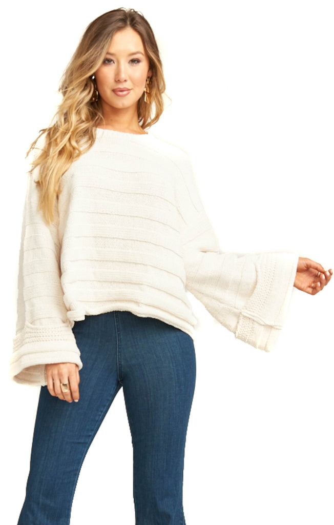cream knit pullover with bell sleeves