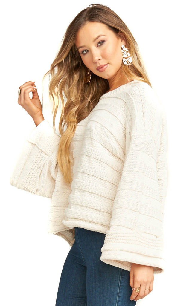 side of show me your mumu cream knit pullover with bell sleeves