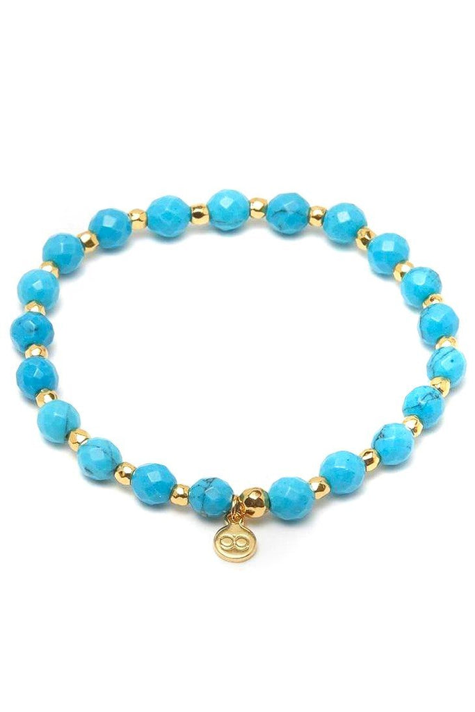 turquoise beaded bracelet with gold details