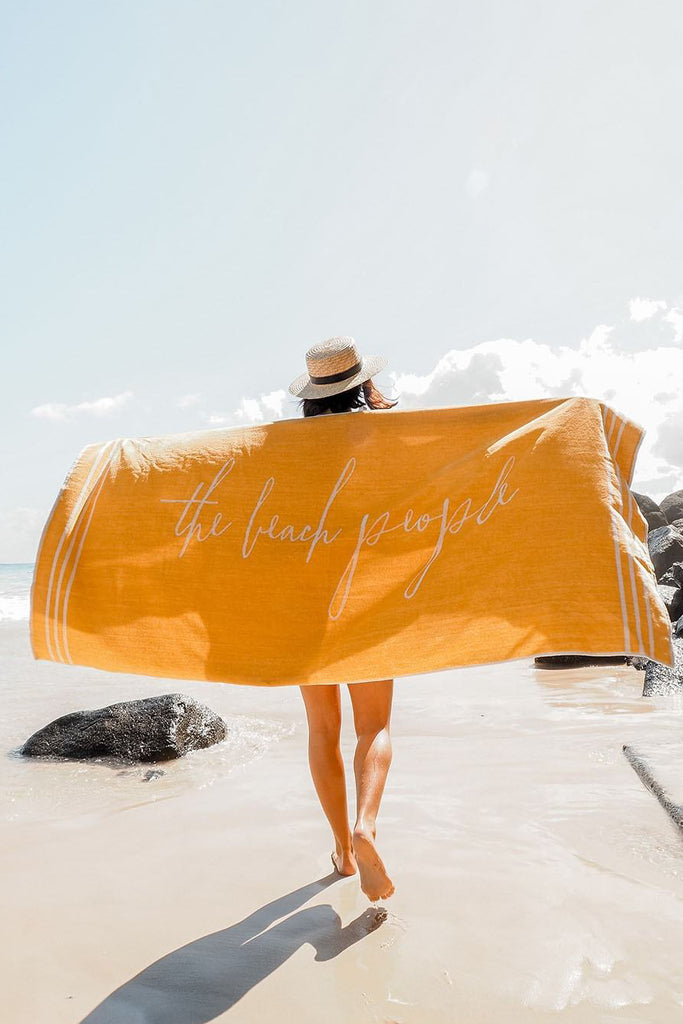 Tuscan Yellow Signature Towel - on beach