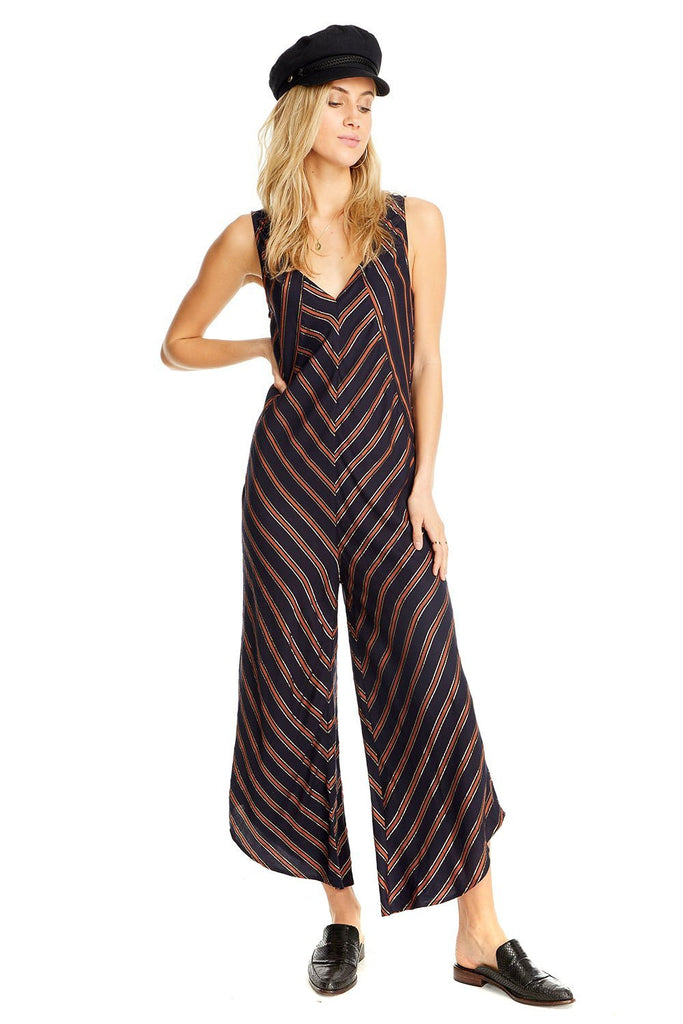 navy and orange criss cross metallic stripe jumpsuit