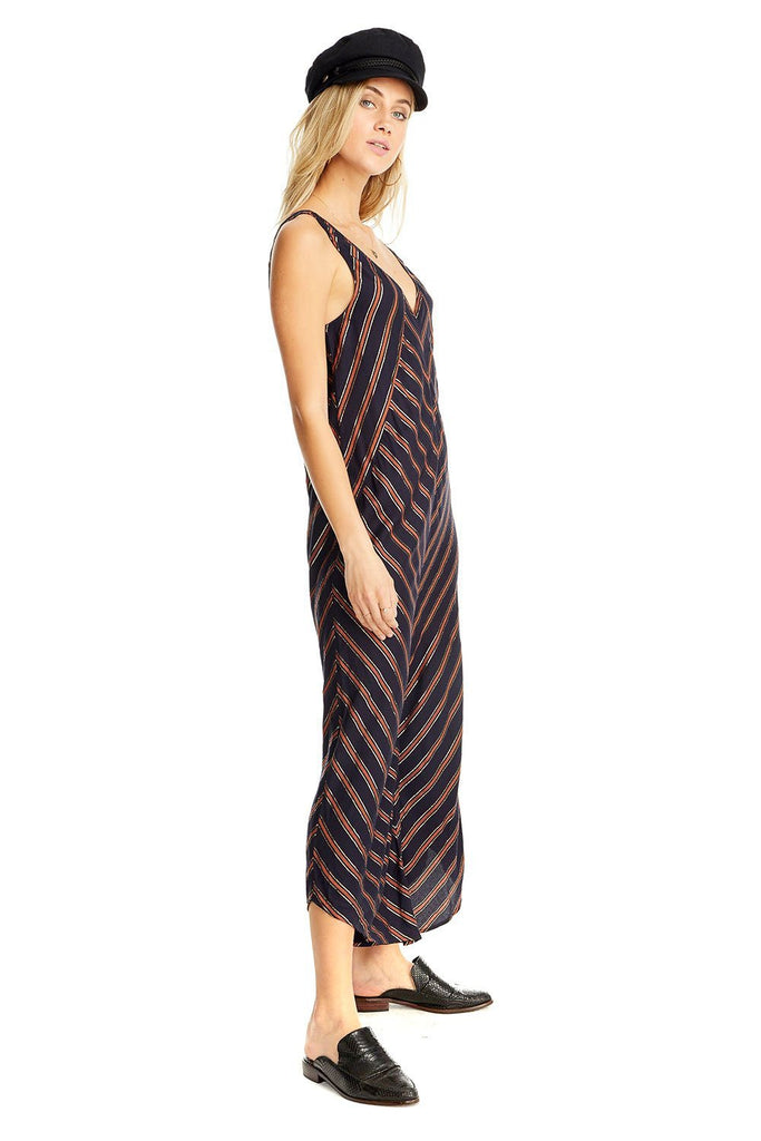 navy and orange criss cross metallic stripe jumpsuit with asymmetrical hem
