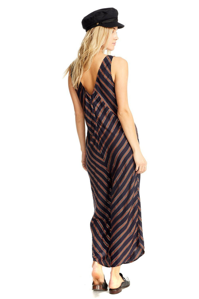 back of saltwater luxe navy and orange criss cross metallic stripe jumpsuit