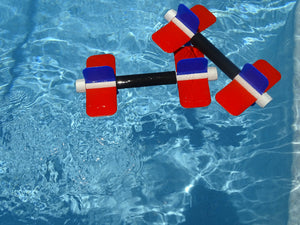 Pair of Aqua Bladez floating in pool water
