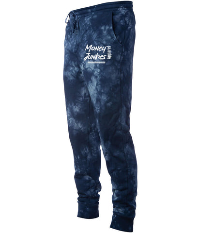 "Blue tie-dye joggers in a cotton-polyester blend, with pockets, elasticated waistband, and drawcord, branded ""Money Junkies Apparel""."