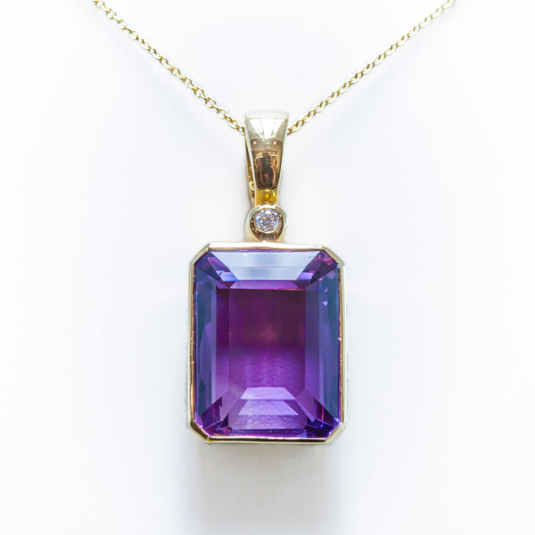 Amethyst Necklace in Yellow Gold with one Diamond