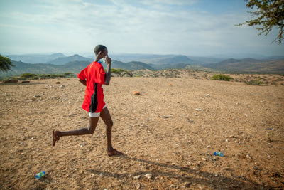 Do Kenyans run or train barefoot?