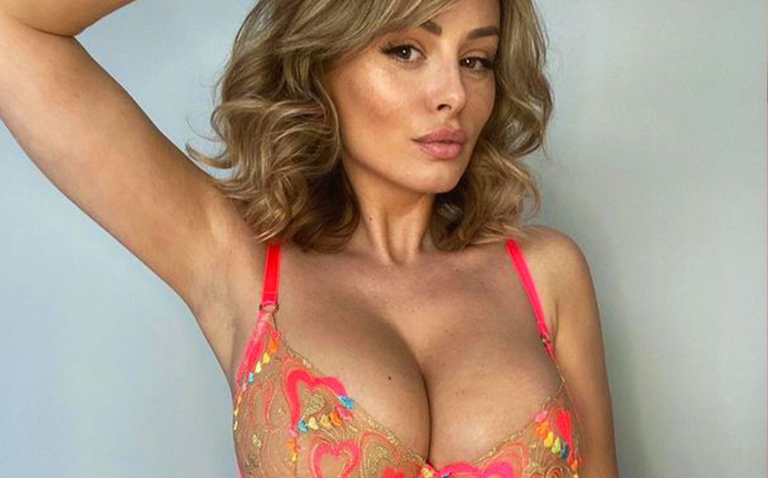 Rhian Sugden flaunts mega cleavage in colourful Honey Birdette nude illusion lingerie display | DailyStar