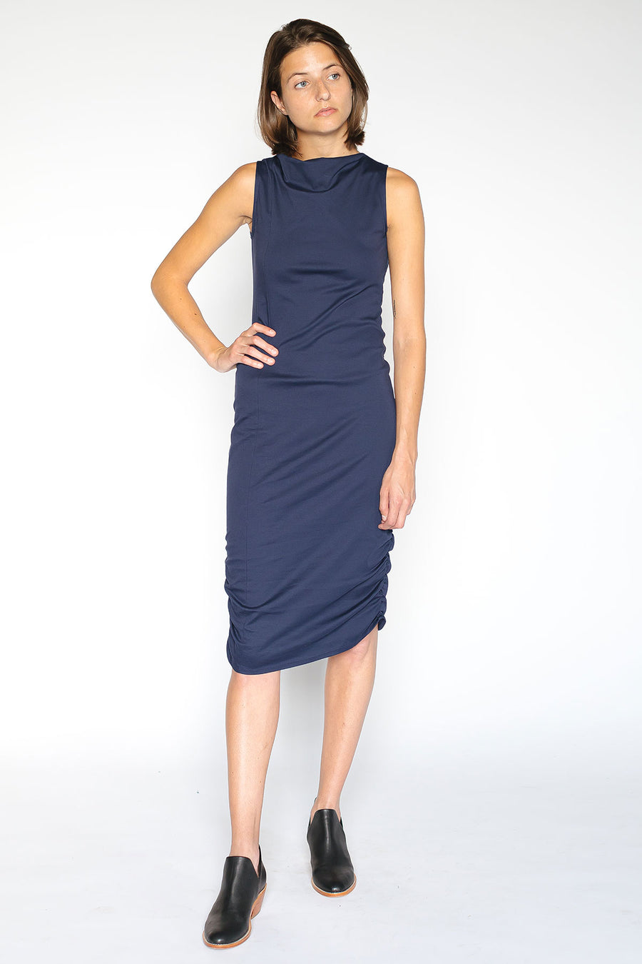 Sleeveless navy dress with asymmetrical neckline
