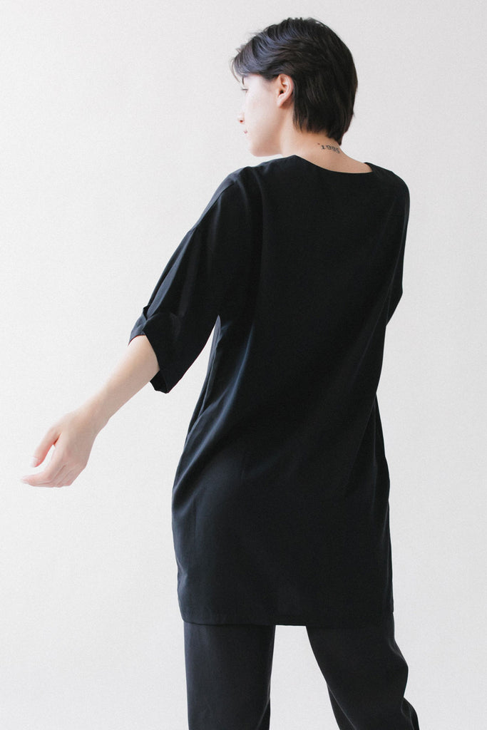 Black tunic dress with short sleeves