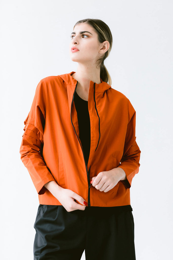 Waterproof windbreaker jacket with pleated sleeves