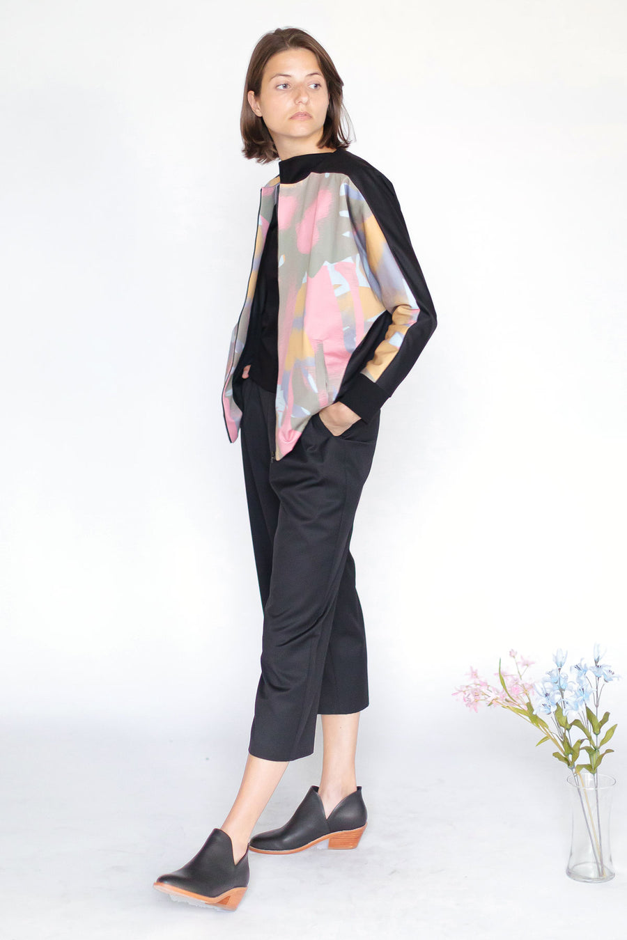Bomber jacket with black and pink abstract print