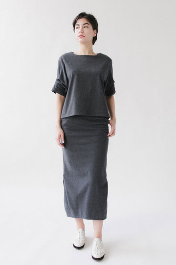 gray short sleeve cotton shirt and gray midi skirt