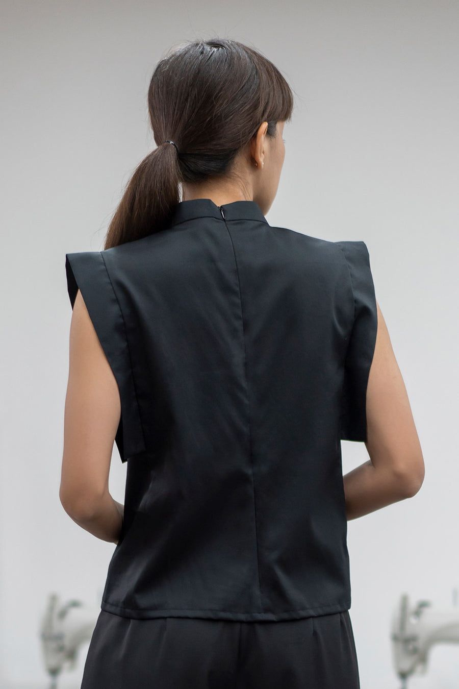 Black sleeveless top with mandarin collar