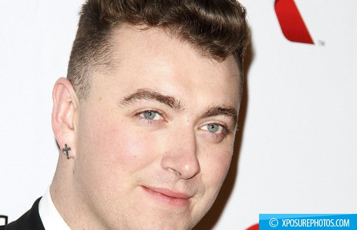 Singing sensation Sam Smith has fun in the sun as he continues to show off the results of his recent weight loss