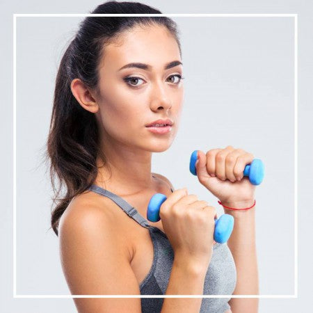 Woman excersing with 2 small dumbbells