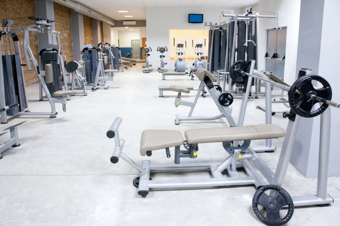 Empty gym with weight equipments