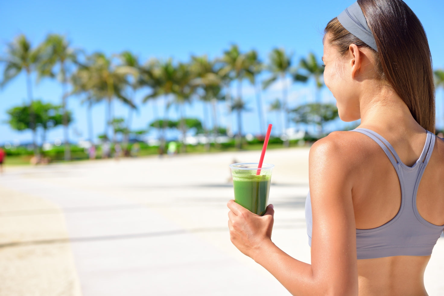 Green smoothie on a sunny beach