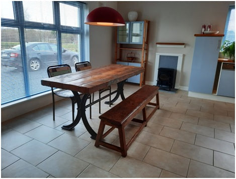 Farmhouse table with 3 seats and a bench in a kitchen interior