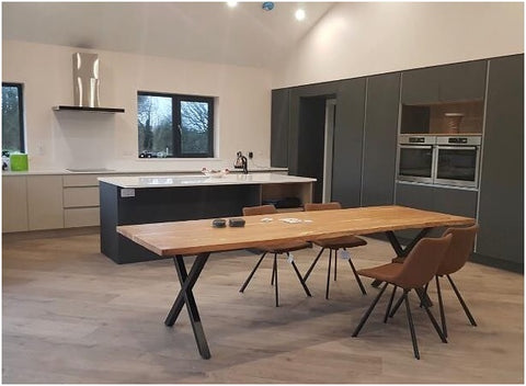 Large reclaimed wooden table in a modern interior