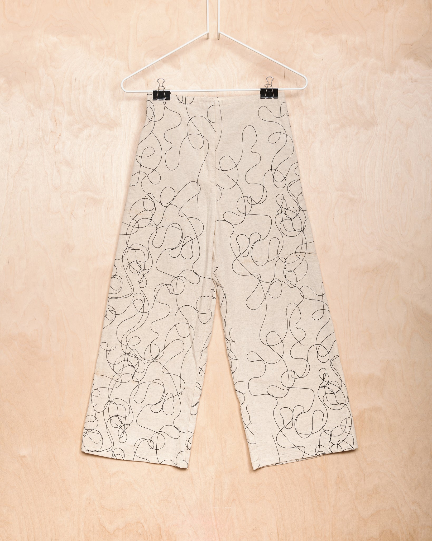 Natural Pants With Curlicued Pattern