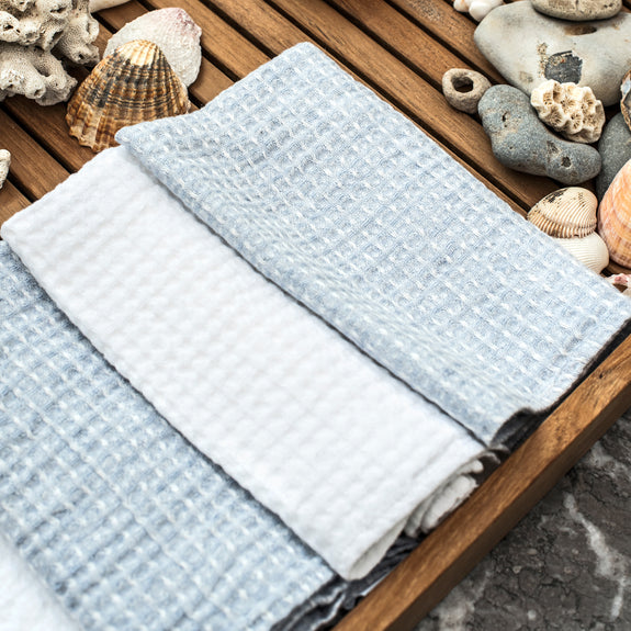 linen towel waffle swan white face light blue face folded