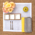 linen napkin yellow linen placemat white fishbone