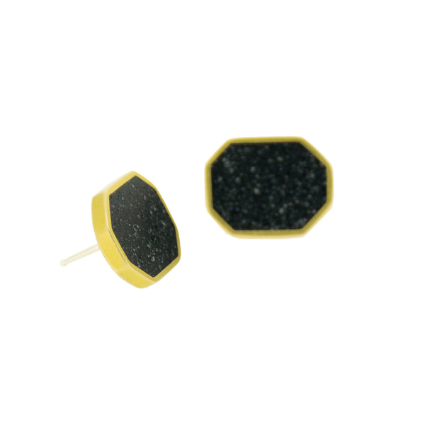 Concrete cluster earrings with black pigmented concrete in a brass long octagon shaped setting