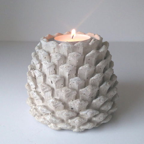 Concrete fir cone candle holder