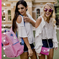 SCORE!'s  Natalie Michelle Large Backpack for sororities like Gamma Delta and Eva classic crossbody clutch handbag in Pink and White for Phi Mu & Breast Cancer Awareness