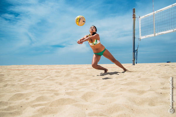 Interested in learning how to play beach volleyball?