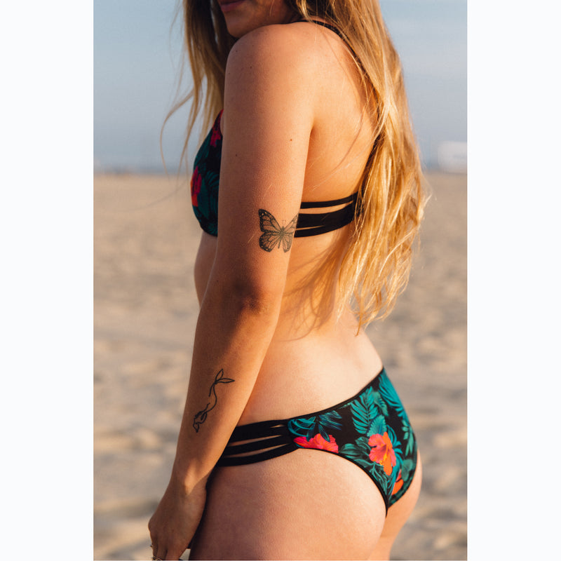 reversible sport bikini bottom california coverage black tropical hibiscus El Matador beach volleyball surfing Pepper Swimwear active beach lifestyle