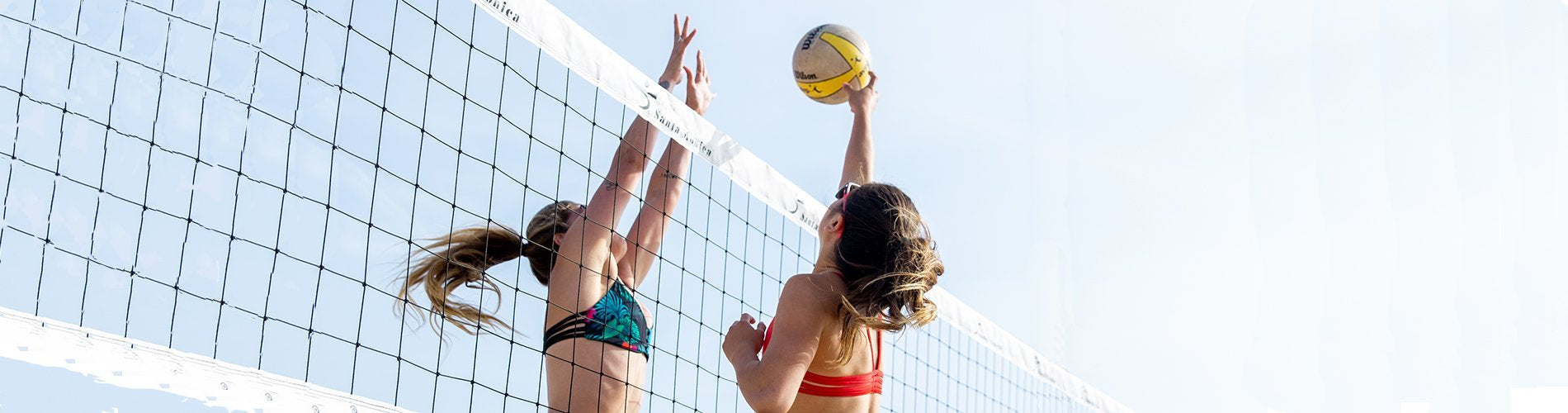 Beach volleyball player diving Pepper Swimwear active lifestyle