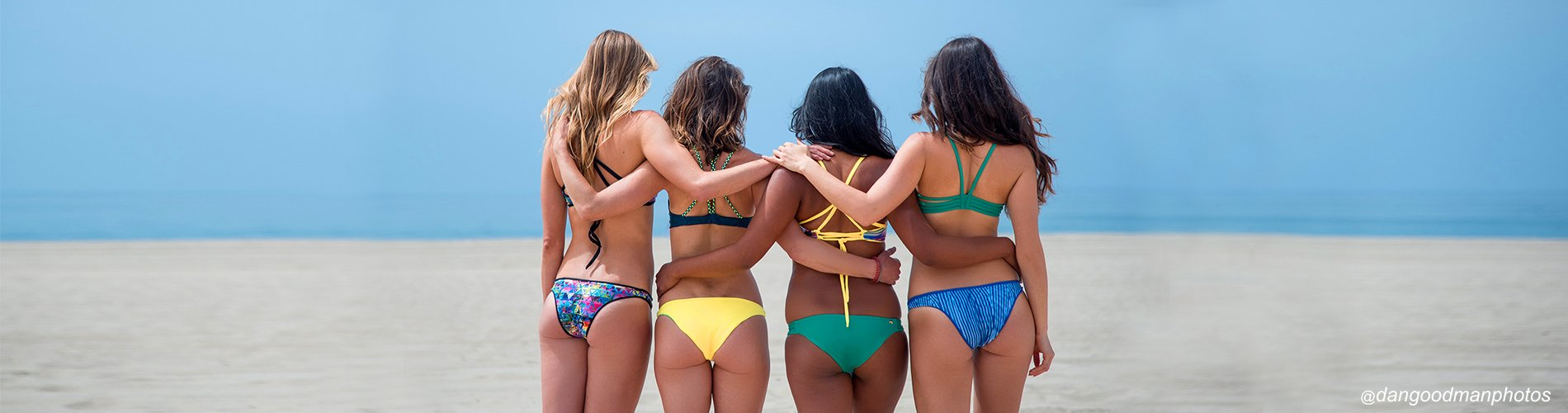 Four friends come together to play beach volleyball Pepper Swimwear active lifestyle