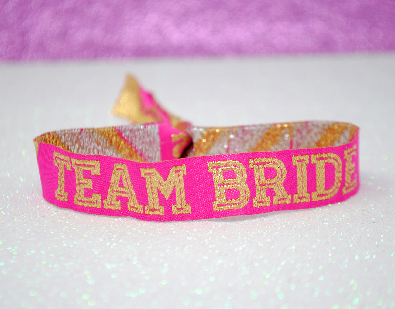 team bride hen party wristbands pink and gold