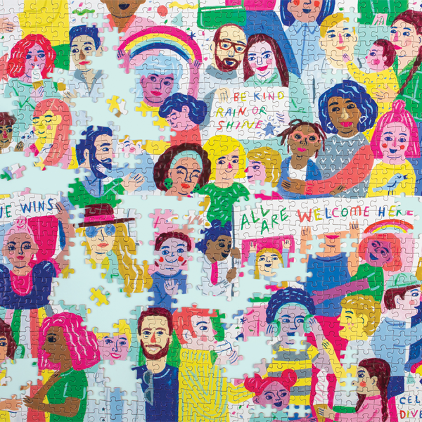 The completed puzzle reveals a colorfully illustrated collage showcasing human diversity and acts of kindness with positive mantras for living and inclusion.