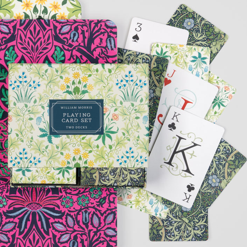 The set features two standard size decks of playing cards in the famous Celandine and Seaweed designs