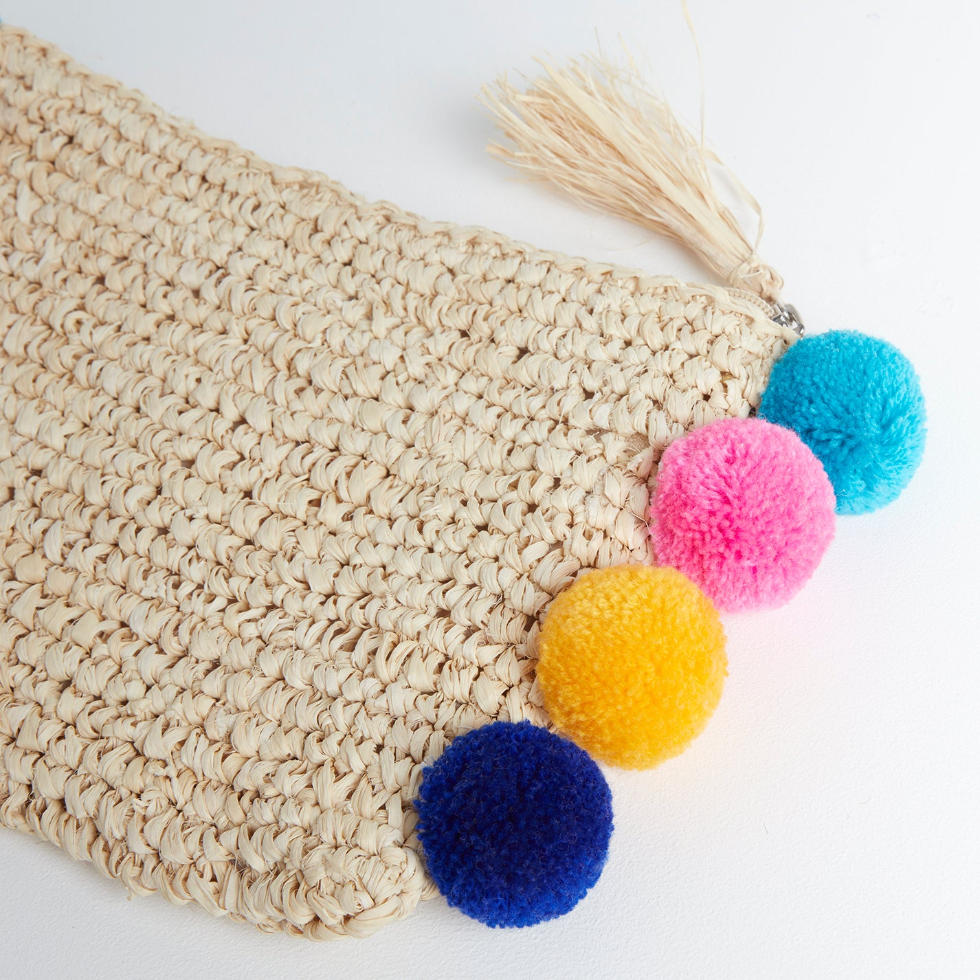 Castell Coloured Pom Pom Clutch Bag