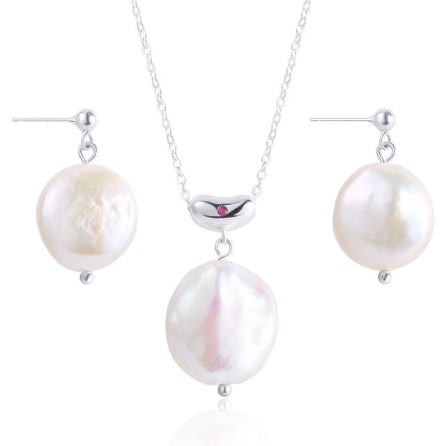 Baroque Pearl Necklace and Earrings are perfectly imperfect and timeless.  925 Sterling Silver and 14k Gold Plated.