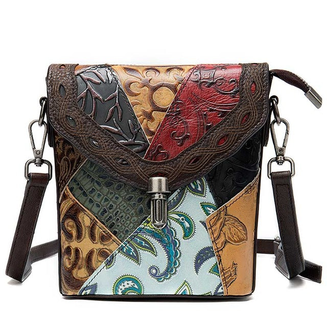 leather embossed bag features a flap with stand out western details