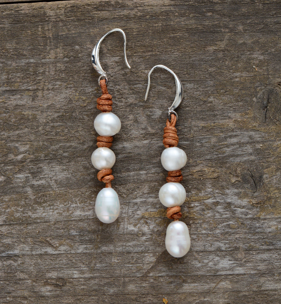 These earrings are 8mm freshwater pearls on leather.