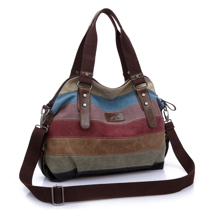 Large tote/messenger bag.  Holds everything you need.